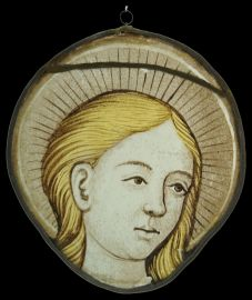 A beautiful Stained Glass Roundel depicting an Angel circa 1550