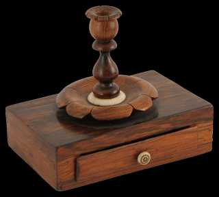 An early 19th Century Rosewood and Ivory Candle and Sealing Wax Holder